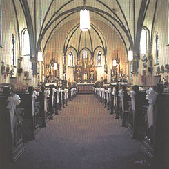 Photo of the aisle inside the Twin Spires church